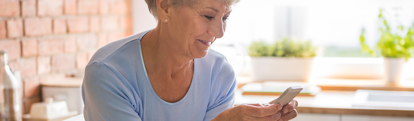 Woman checking account balance on phone
