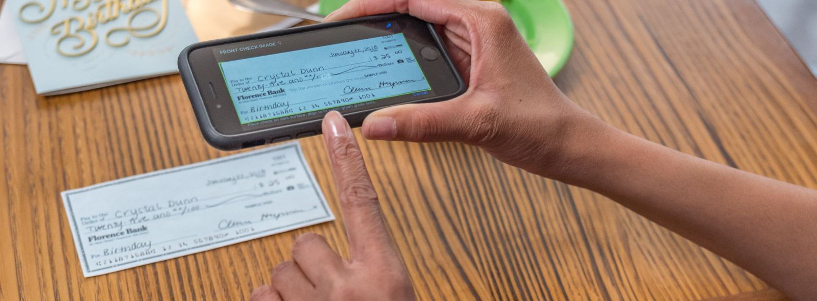 Mobile deposit capturing a check image on mobile device.