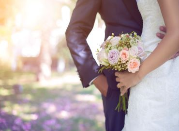 Picture of bride and groom holding bouquet